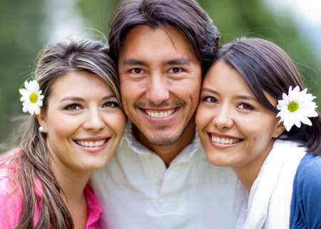 Man and two lovely girls - siblings portrait outdoors  Stock Photo - 12620037