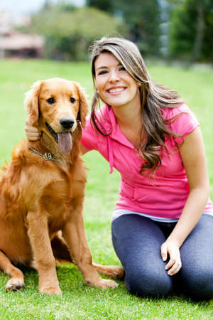 dog park: Young woman smiling with a dog at the park