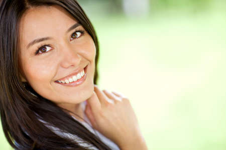 Portrait of a beautiful Latin woman smiling - outdoors  photo