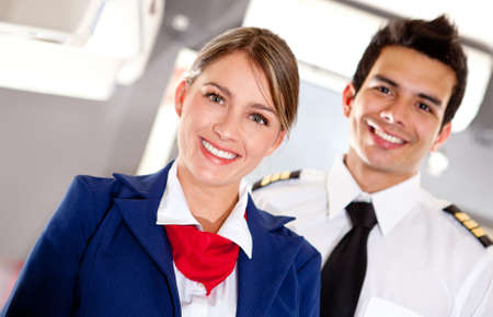 air hostess: Airplane cabin crew with pilot and flight attendant smiling