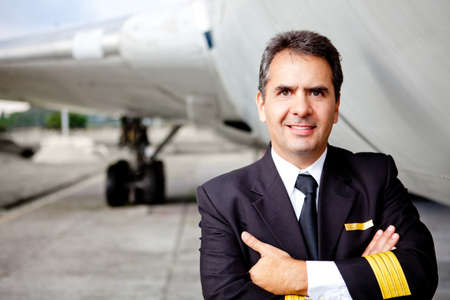 Portrait of a commercial airplane pilot smiling  photo