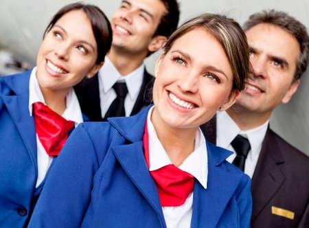 air hostess: Portrait de l'�quipage de cabine d'avion convivial air heureux Banque d'images