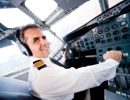airplane background: Pilot sitting in an airplane cabin flying  Stock Photo