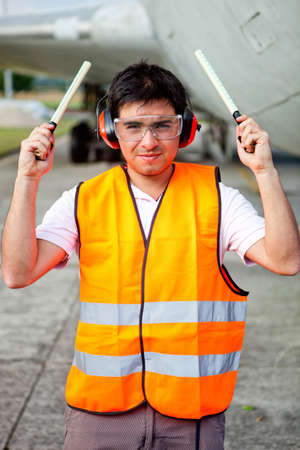 Air traffic controller holding light signal at the airport  photo