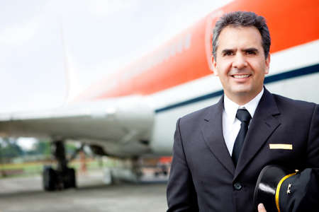 airliner: Handsome airplane pilot at the airport smiling