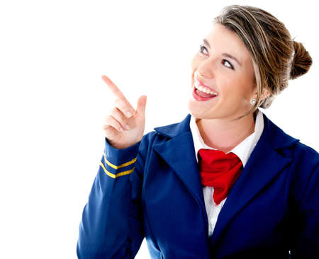 Air hostess pointing  with her finger - isolated over a white background photo