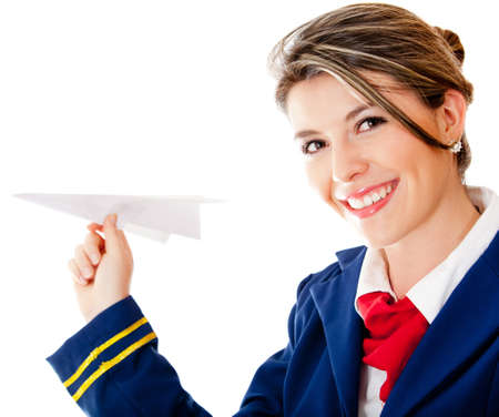 Flight attendant holding a paper airplane - isolated over a white background photo