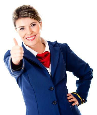 Friendly air hostess with thumbs up - isolated over a white background photo