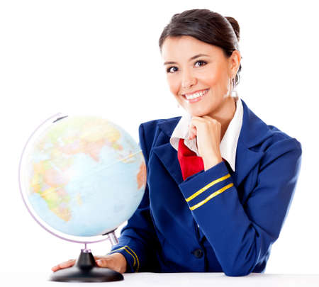 Flight attendant with the globe choosing the next destination - isolated over white  photo