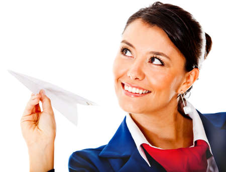 Air hostess holding a paper airplane - isolated over a white background photo