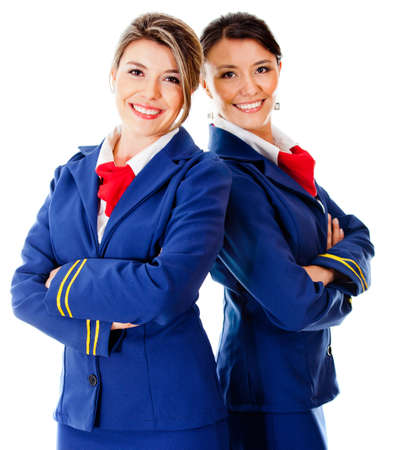 air crew: Beautiful Air hostesses - isolated over a white background