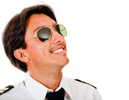 Male pilot wearing sunglasses looking up - isolated over a white background  photo
