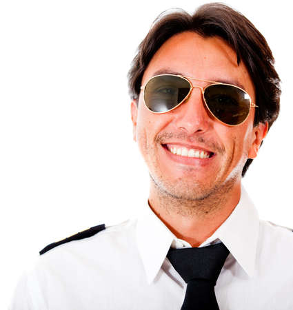 Handsome male pilot smiling - isolated over a white background photo