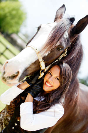 horseback: Portrait of a beautiful woman with a horse outdoors