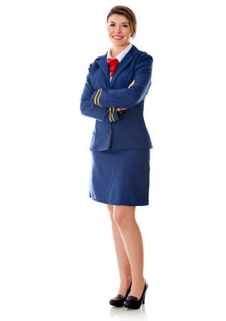 air hostess: Flight attendant standing wit arms crossed - isolated over a white background