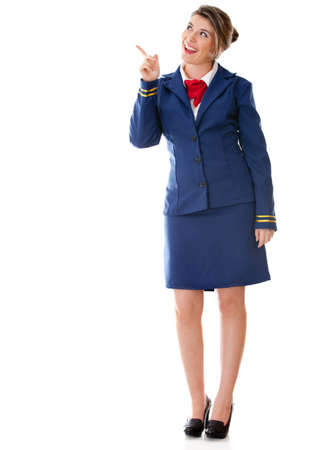 Flight attendant pointing with her finger - isolated over a white background Stock Photo - 12619874