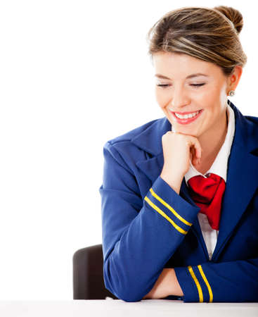 Air hostess looking at the table - isolated over a white background  photo