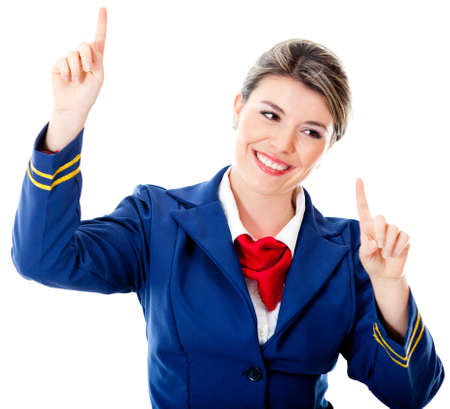 Flight attendant touching an imaginary screen with her fingers photo