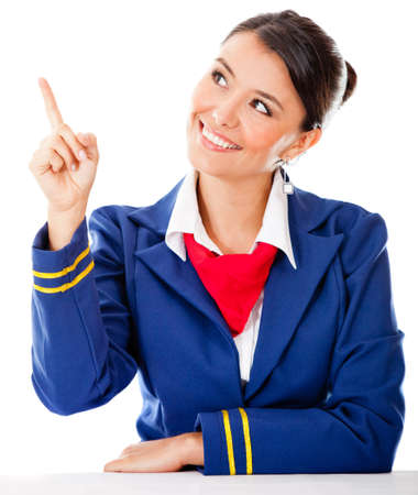Beautiful air hostess pointing with her finger - isolated over a white background photo