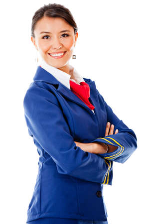 air crew: Beautiful air hostess with arms crossed - isolated over a white background