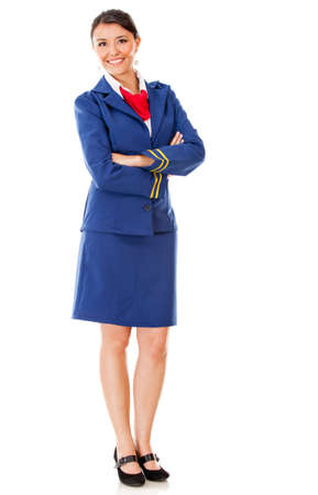Fullbody flight attendant standing isolated over a white background photo