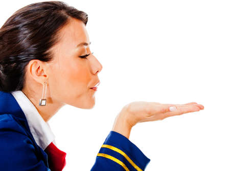 Flight attendant blowing into her hand - isolated over white  photo