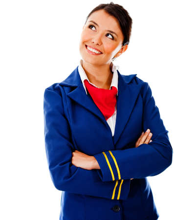air crew: Thoughtful flight attendant looking up - isolated over a white background