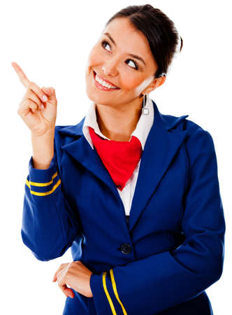 Beautiful flight attendant pointing with her finger - isolated over a white background photo