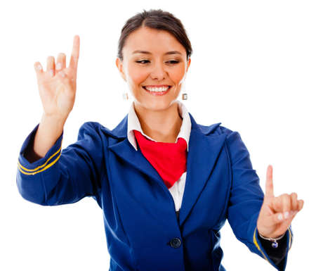 Flight attendant pointing two destinations - isolated over a white background photo
