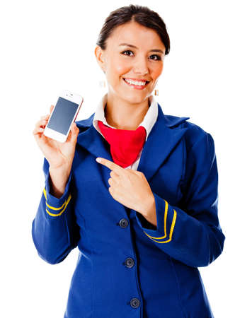 Air hostess holding a smart phone - isolated over a white background photo