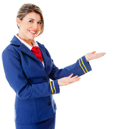 welcoming: Welcoming flight attendant smiling - isolated over a white background