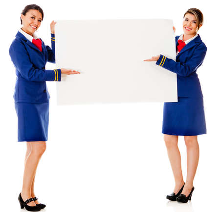 Air hostesses holding a banner - isolated over a white background photo