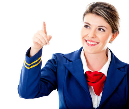 Air hostess pointing with finger – isolated over a white background  photo