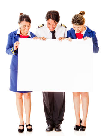 Airplane cabin crew holding banner – isolated over a white background photo