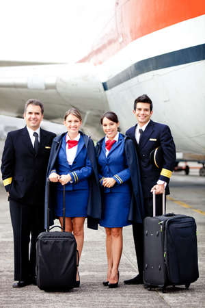 airhostess: Pilots and air hostesses ready to fly in an airplane  Stock Photo