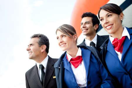 air hostess: Portrait d'un �quipage de cabine d'avion en souriant