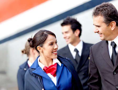Pilots and air hostesses getting off the airplane  photo