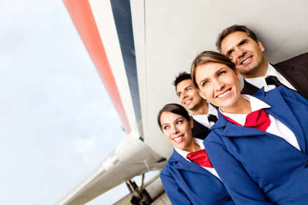 aviators: Airplane cabin crew at the airport smiling