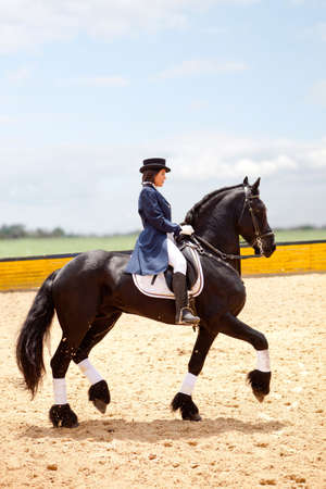 ringmaster: Beautiful female horse breaker with a horse and wearing an outfit Stock Photo