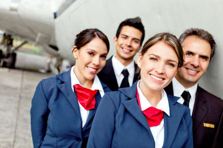 air hostess: Cabin crew team with pilots and flight attendants smiling