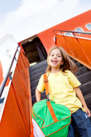 Happy boy going on holidays by airplane Stock Photo - 12619706