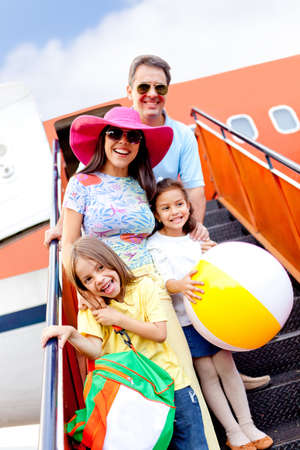 Happy family going on holidays by airplane  photo