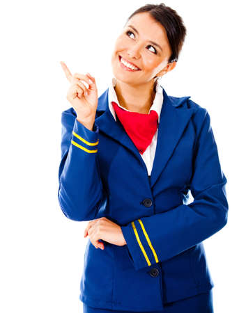 Toughtful flight attendant pointing - isolated over a white background photo