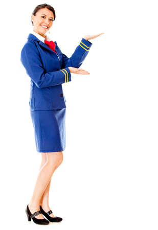 air hostess: Welcoming air hostess smiling - isolated over a white background