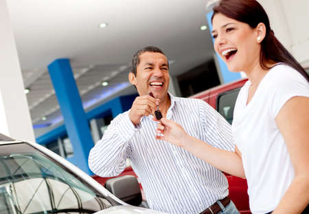 handling: Man buying a car for his wife and handling her the keys