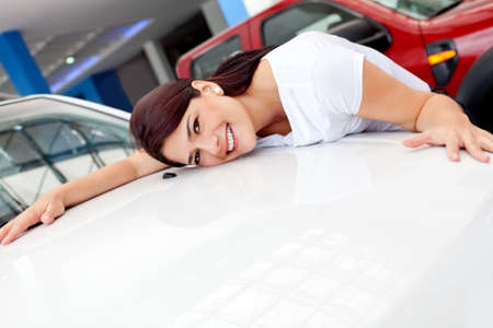 Woman buying a car and falling in love with one model  Stock Photo - 12619705
