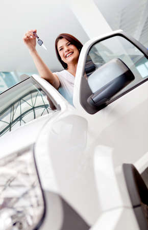 Happy woman buying a car and holding the keys  photo
