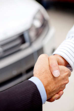 Business handshaking to close the deal after buying a car photo