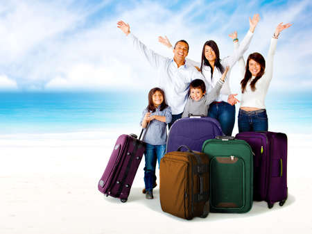 excitement: Happy family excited about a trip with bags and arms up