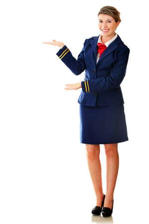 azafata: Auxiliar de vuelo de bienvenida sonriendo - aislados en un fondo blanco Foto de archivo